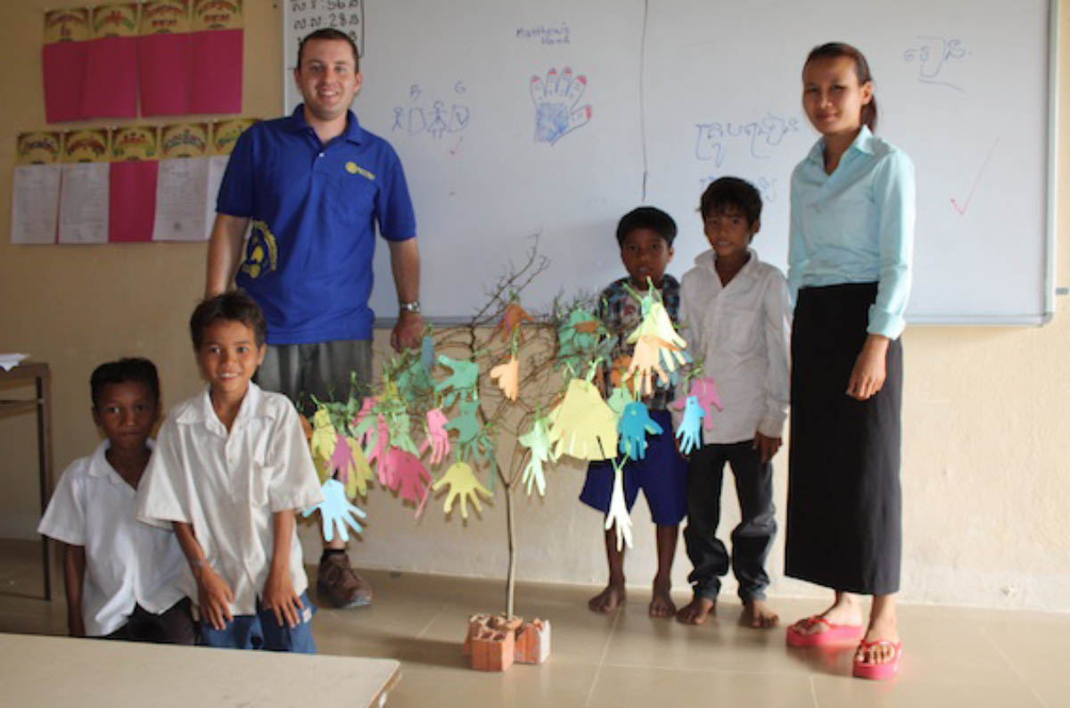 Matthew Scott takes a class at Bosala Primary School in Cambodia, with the regular class teacher and some students.
