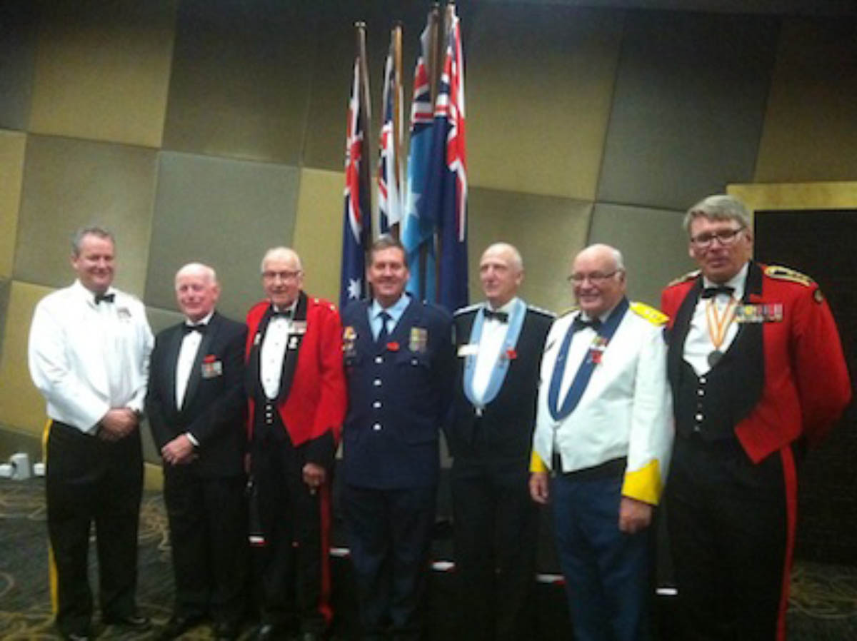 Keynote speaker, Mr Dean Simmons and RSL sub-branch President, Mr Cliff Richard with club members attired in 'mess dress' representing the armed forces, CFA, SES and Victoria Police.